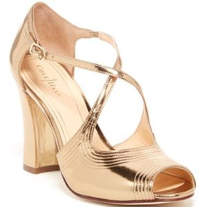 Gently used Cole Haun gold high heeled sandal.